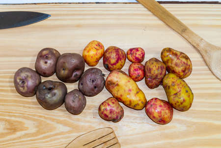 regional potatoes from the Andes at a market in Peru, Bolivia, Argentina, south america on a wooden table. Selective focus Reklamní fotografie