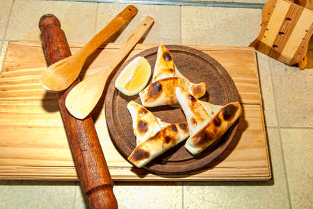 Sfiha, a kind of cake like native to Syria and Lebanon and widely consumed around the world, on a rustic wooden table.