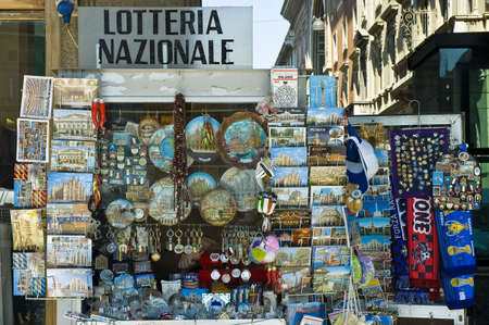 edifice: One of the many souvenirs shops that we can find along the Piazza del Duomo in Milan.