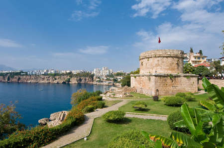 The old Hidirlik Tower watches over Antalyas harbour. Stock Photo