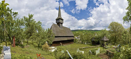 rumania: Traditional church of northern Romania with the typical cemetery.