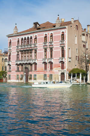 Rezzonico Palace entrance viewed from the Canale Grande Venice, Italy photo