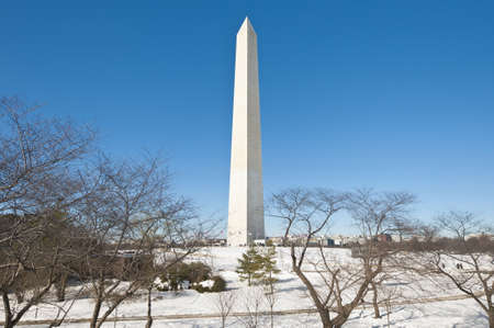 The Washington Monument after a snow blizzard at the Mall in DC, USA photo