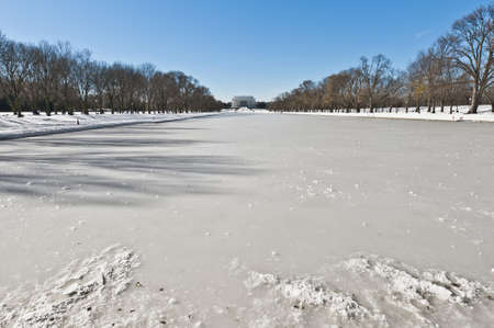 The Reflecting Pool after a snow blizzard at the Mall in DC, USA photo