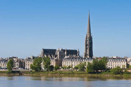 Fleche of Saint Michel as seen from the other shore of Garonne river on its way through Bordeaux, France
