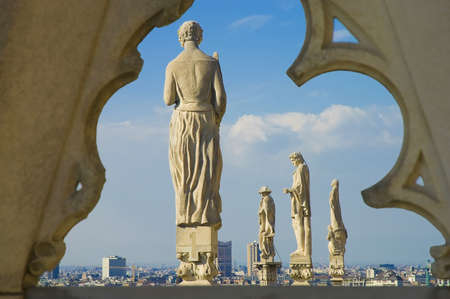 Statues at the roof of Il Duomo di Milano, the fourth-largest church in the world. Stock Photo