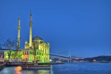 edifices: Night in Ortakoy Mosque on the Bosphorus shore at Istanbul Stock Photo