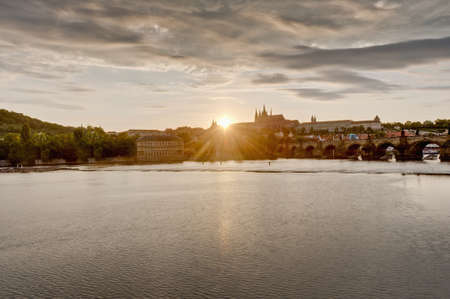 seem: Sunset on Vltava river as seem from Rasinovo Street