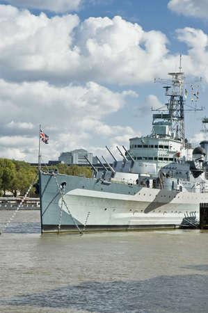 armaments: HMS Belfast light cruiser battle ship at London
