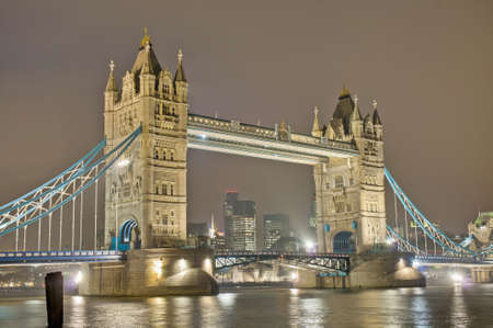 Tower Bridge across Thames river at London, England photo