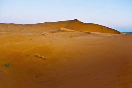 erg: Sun rises over Erg Chebbi dunes at Morocco Stock Photo