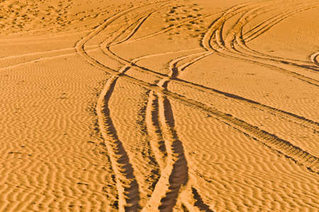 erg: Quad and motorcycles tracks on Erg Chebbi at Morocco Stock Photo