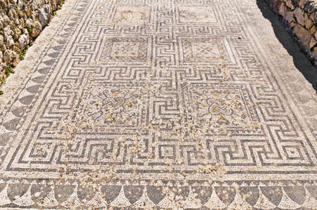 Roman detailed mosaics on Dyonysus and the Four Seasons house at Volubilis, Morocco photo
