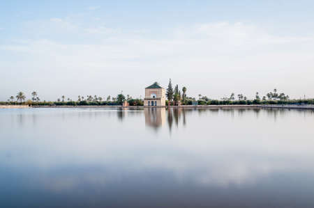 morocco: Pavillion reflection on Menara Gardens basin at Marrakech, Morocco Stock Photo