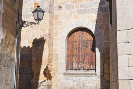 Old streetlamp and wooden window on a narrow street at Avila, Spain Stock Photo - 17245486