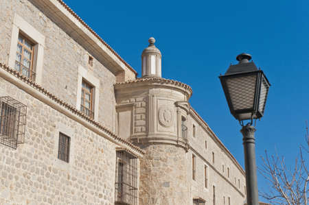 Defensive walls tower around Avila, Spain photo