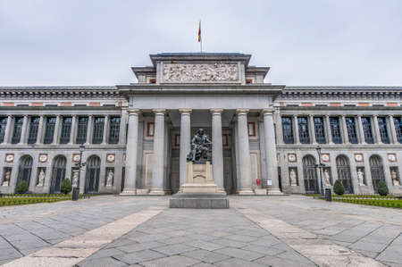 Prado Museum facade and Cervantes statue at Madrid, Spain