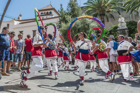 SITGES, SPAIN - AUG 23: Ball de Cercolets group on Cercavila performance within the Festa Major celebrations Aug 23, 2012 in Sitges, Spain. Stock Photo - 17228712