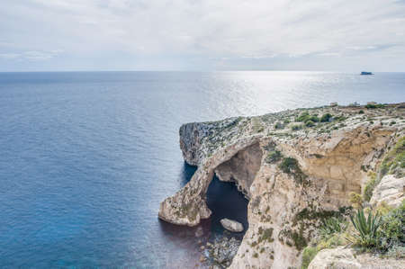 islet: Blue Grotto (Taht il-Hnejja) cavern on the southern coast of Malta, near the village of Zurrieq and the small uninhabited islet of Filfla. Stock Photo