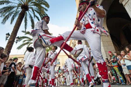 festividad: VILANOVA I LA GELTRU, SPAIN - AUG 04: Balls the Bastons dancers at the Cercavila performance within the Festa Major celebrations Aug 04, 2011 in Vilanova i la Geltru, Spain. Editorial