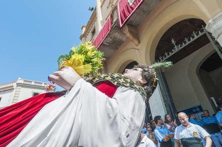 festividad: SITGES, SPAIN - AUG 23: Gegant de la Vila  on Cercavila performance within the Festa Major celebrations Aug 23, 2012 in Sitges, Spain.
