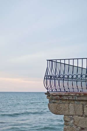 Balcony fence in front of the mediterranean sea in Sitges, Spain photo