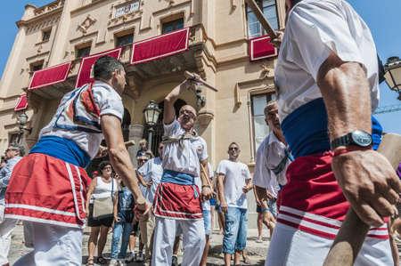 festividad: SITGES, SPAIN - AUG 23: Ball de Bastons group on Cercavila performance within the Festa Major celebrations Aug 23, 2012 in Sitges, Spain.