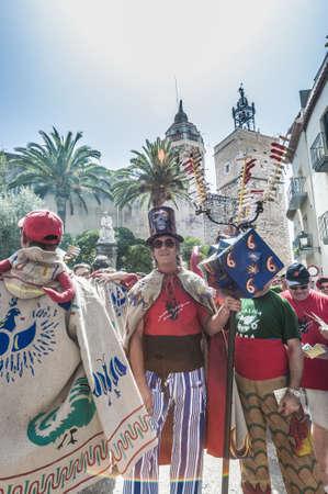 festividad: SITGES, SPAIN - AUG 23: Ball de Diables group on Cercavila performance within the Festa Major celebrations Aug 23, 2012 in Sitges, Spain.