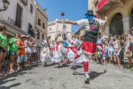 cercavila: SITGES, SPAIN - AUG 23: Ball de Gitanes group on Cercavila performance within the Festa Major celebrations Aug 23, 2012 in Sitges, Spain. Editorial