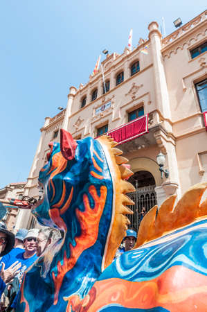 festividad: SITGES, SPAIN - AUG 23: Drac fantastic figure on Cercavila performance within the Festa Major celebrations Aug 23, 2012 in Sitges, Spain.