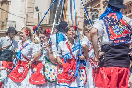 festividad: SITGES, SPAIN - AUG 23: Ball de Gitanes group on Cercavila performance within the Festa Major celebrations Aug 23, 2012 in Sitges, Spain. Editorial