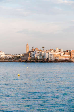 Sitges skyline as seen from the sea on southern Barcelona in Catalonia Province, Spain Stock Photo