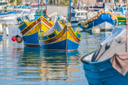 Traditional Luzzu boat at Marsaxlokk harbor, a fishing village located in the south-eastern part of Malta. Stock Photo