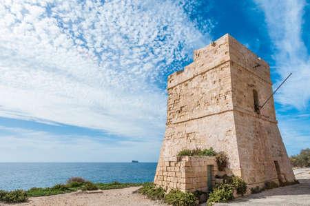 Coastal watch tower near Blue Grotto in Malta Stock Photo