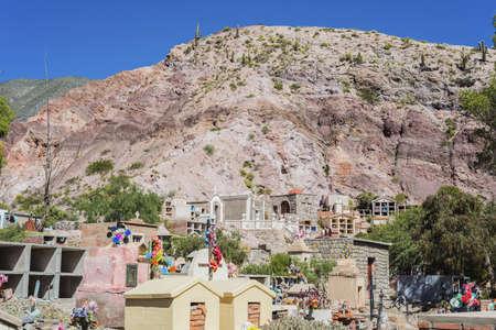 colores: Cemetery in Purmamarca, near Cerro de los Siete Colores (The Hill of Seven Colors), in the colourful valley of Quebrada de Humahuaca in Jujuy Province, northern Argentina.