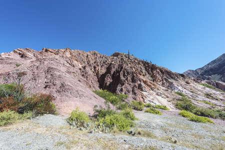 siete: Los Colorados path in Purmamarca, near Cerro de los Siete Colores (The Hill of Seven Colors), in the colourful valley of Quebrada de Humahuaca in Jujuy Province, northern Argentina.
