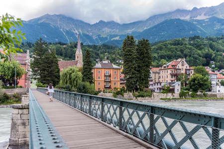 kilometres: Innsteg bridge across the Inn, a 517 kilometres long tributary of the Danube on its way through Innsbruck, Upper Austria.