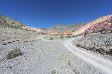 siete: Los Colorados path in Purmamarca, near Cerro de los Siete Colores (The Hill of Seven Colors), in the colourful valley of Quebrada de Humahuaca in Jujuy Province, northern Argentina.