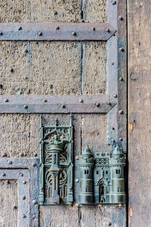 made in belgium: City Hall medieval bronze made lock and door pull in Mons, capital of the Wallonian province of Hainaut in Belgium. Stock Photo