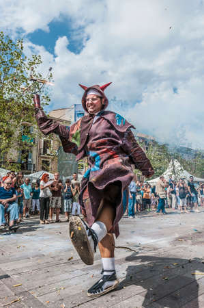 patron of europe: VILAFRANCA DEL PENEDES, SPAIN - AUG 29: Ball de Diables dance on Cercavila performance within the Festa Major celebrations Aug 29, 2012 in Vilafranca del Penedes, Spain.