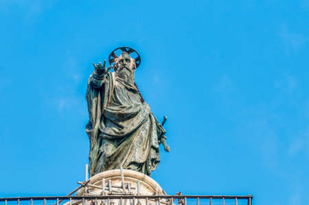 Bronze statue of Saint Paul that crowns the marble Column of Marcus Aurelius which has stood on Piazza Colonna since 193 CE in Rome, Italy.