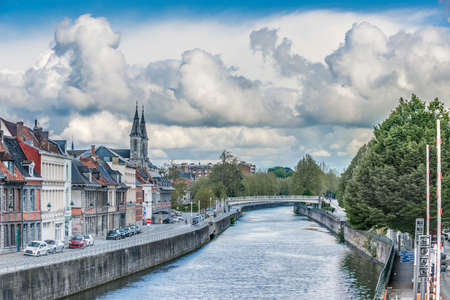 Escaut River passing through Tournai, on the Hainaut province of the Wallonian region in Belgium. Editorial