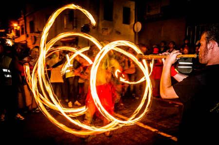 fireruns: VILAFRANCA DEL PENEDES, SPAIN - SEP 01: Correfoc performance within the Festa Major celebrations Sep 01, 2012 in Vilafranca del Penedes, Spain. Editorial
