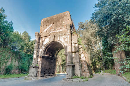 caput: Arch of Drusus (Arco di Druso), an ancient arch in Rome, Italy, close to the First Mile of the Appian Way and next to the Porta San Sebastiano. Stock Photo