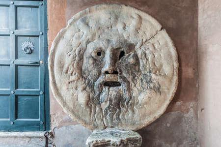 The Mouth of Truth (La Bocca della Verità) carved from Pavonazzo marble, in the portico of the church of Santa Maria in Cosmedin in Rome, Italy.