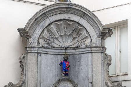 spoken: Manneken Pis(literally Little Man Pee in Marols, a Dutch dialect spoken in Brussels, also known in French as le Petit Julien), the a famous Brussels landmark in Belgium.