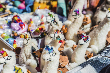 colores: Made of wool llamas souvenirs in Purmamarca, near Cerro de los Siete Colores (The Hill of Seven Colors), in the colourful valley of Quebrada de Humahuaca in Jujuy Province, northern Argentina.