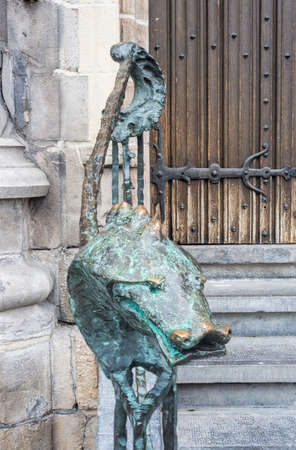 walloon: Dragon bronze railing adorns the entrance staircase of the City Hall in Mons, capital of the Wallonian province of Hainaut in Belgium.