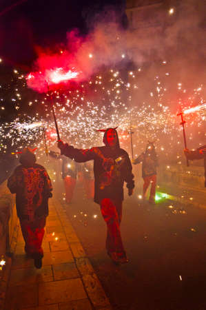 fireruns: EL VENDRELL, ES - JUL 29: Fireruns at the Festa Major celebrations Jul 29, 2011 in El Vendrell, ES.