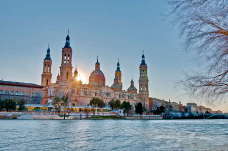 Our Lady of the Pillar Basilica as seen from the north shore of Ebro River at Zaragoza, Spain photo
